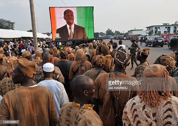 Traditional hunters called Dozo watch on a giant screen a speech by Ivory Coast's President Alassane Ouattara during a meeting with the population of...