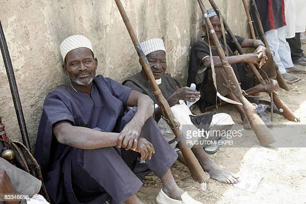 Traditional hunters sit beside their dane guns at the historic first Talakawa Summit in Nigeria in Dutse Jigawa State on October 18 2008 Top Jigawa...