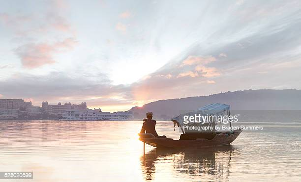 traditional indian boat on lake pichola. - udaipur stock pictures, royalty-free photos & images