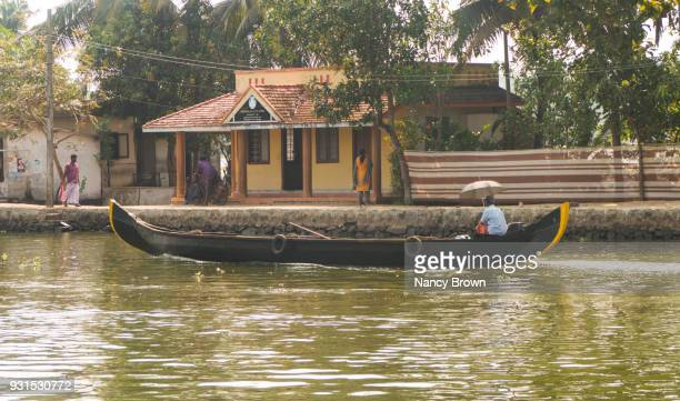 Traditional Indian Snake Boat on Canal in Kerala Backwater in Southern India.