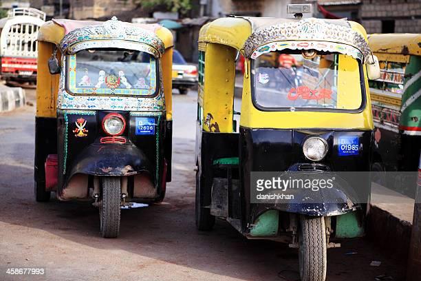 traditional indian style rickshaws in saddar karachi - rickshaw stock pictures, royalty-free photos & images