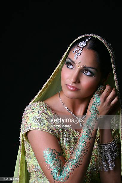 traditional indian woman wearing bridal dress - indian bride stock photos and pictures