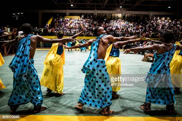 TOPSHOT Traditional Intore dancers perform at the Amahoro Sport complex in Kigali on August 4 2017 as the country awaits the results of the...
