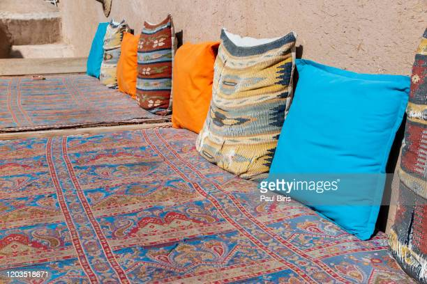 traditional iranian colorful  pillows on the floor in yazd, iran - cushion stock pictures, royalty-free photos & images