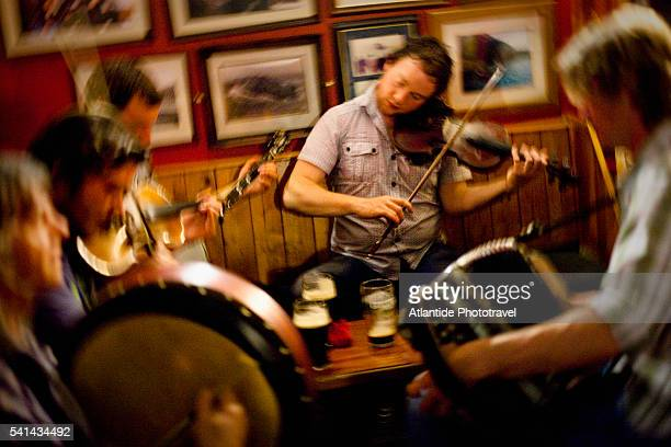 traditional irish music session in a pub, inisheer, county galway, ireland - musical instrument stock pictures, royalty-free photos & images