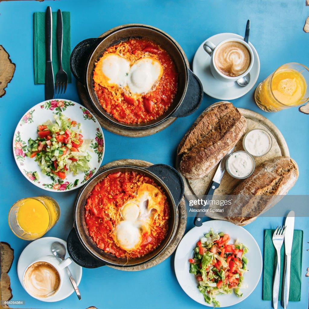 Traditional Israeli breakfast with shakshuka and hummus, Tel Aviv, Israel : Stock Photo