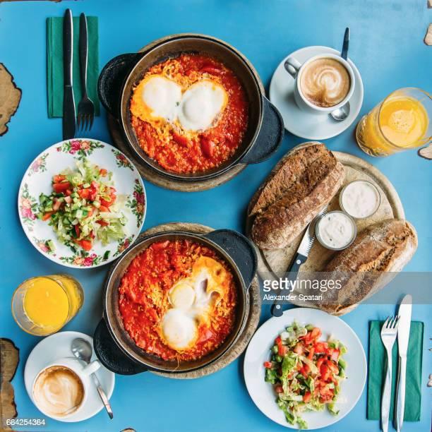 traditional israeli breakfast with shakshuka and hummus, tel aviv, israel - tel aviv stock pictures, royalty-free photos & images