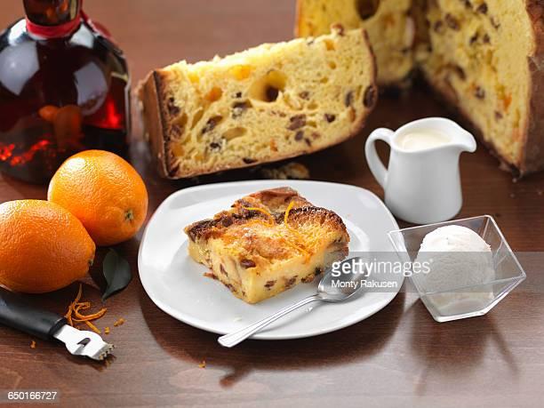 traditional italian dessert of panettone (bread and butter pudding) - panettone foto e immagini stock