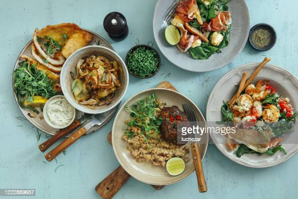 traditional italian dishes for family dinner - milanese stock pictures, royalty-free photos & images
