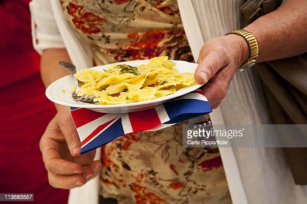 Traditional Italian food is served with a Union Jack napkian for members of the Associations of British Expats in Italy after viewing on television...