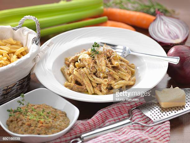 traditional italian meal of pasta ragu dagnello (lamb ragu) - オトレイ ストックフォトと画像