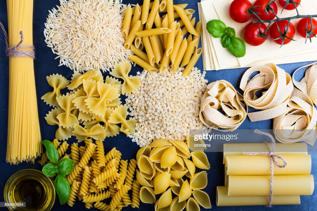Traditional Italian pasta shapes background : Stock Photo