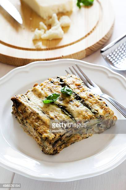 traditional italian recipe of parmigiana di zucchini baked
