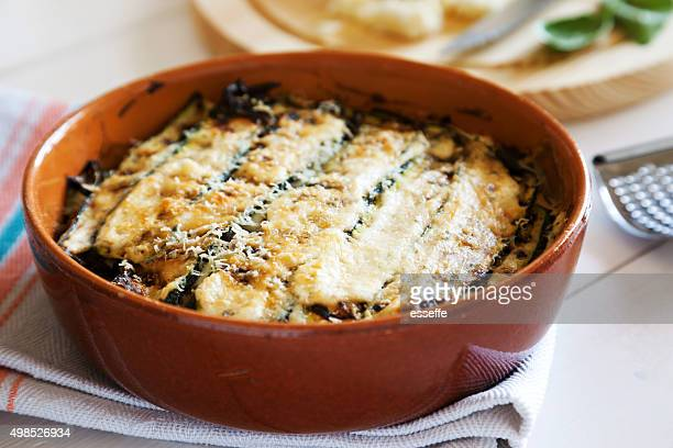 traditional italian recipe of parmigiana di zucchini baked - eggplant stock pictures, royalty-free photos & images