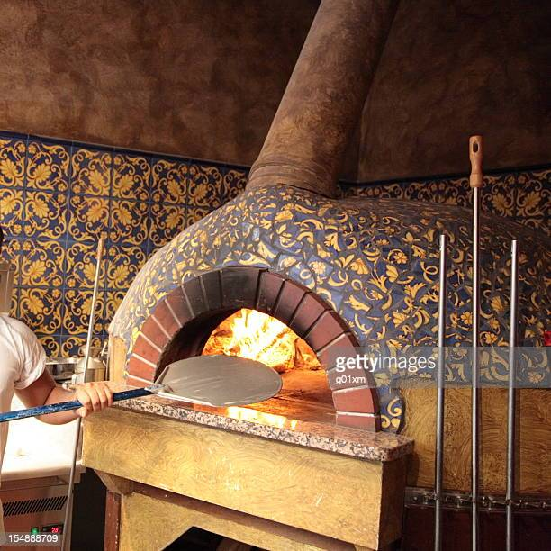 traditional italian wood burning pizza oven - pizza oven stock photos and pictures