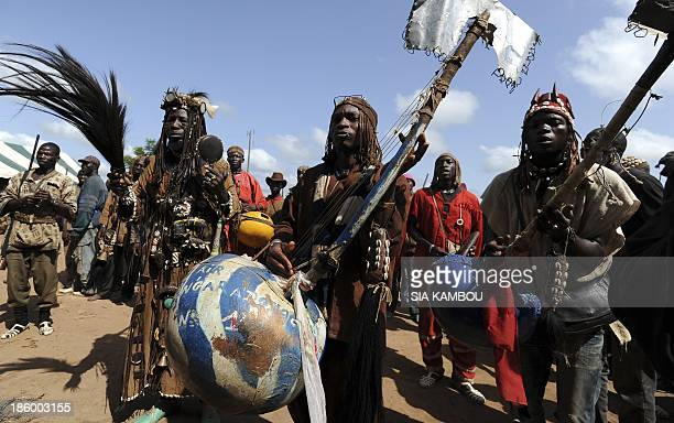 Traditional Ivorian Dozo hunters members of the Binkadi association that gathers all Dozos in the region play music as they arrive on September 27...