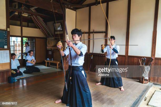 Traditional Japanese archers ready their bows