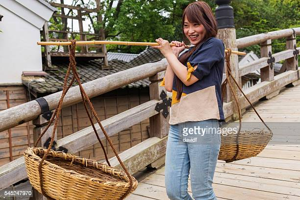 Traditional Japanese Baskets Being Carried by a Young Woman