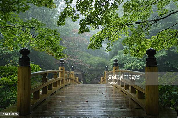 traditional japanese bridge in rain - nikko city stock pictures, royalty-free photos & images