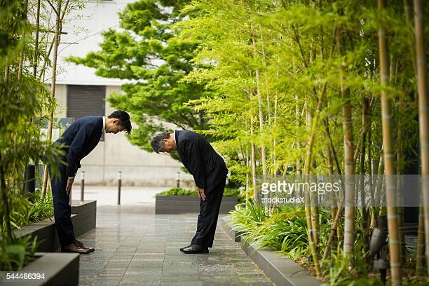 traditional japanese business greeting - japanese culture stock pictures, royalty-free photos & images