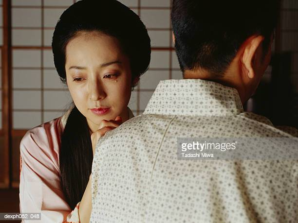 Traditional Japanese couple, woman in tears
