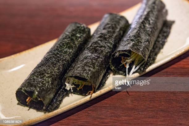 traditional japanese cuisine, food, nori sheets, hand roll (dried, roasted seaweed) - nori stock pictures, royalty-free photos & images