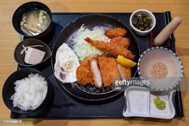 traditional japanese cuisine, fried pork and oyster with vegetable, tonkatsu (pork cutlet) set meal - tonkatsu imagens e fotografias de stock