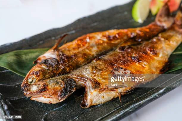 traditional japanese cuisine, grilled fish horse mackerel - trachurus japonicus stock pictures, royalty-free photos & images