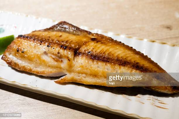 traditional japanese cuisine, japanese style grilled mackerel - jack fish stock pictures, royalty-free photos & images