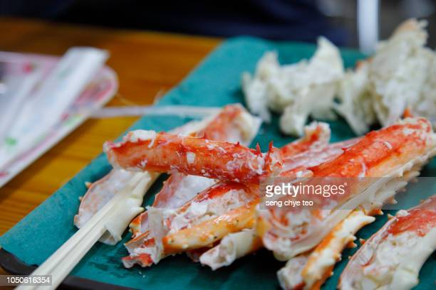 traditional japanese cuisine, king crab legs on plate - crab leg stock photos and pictures