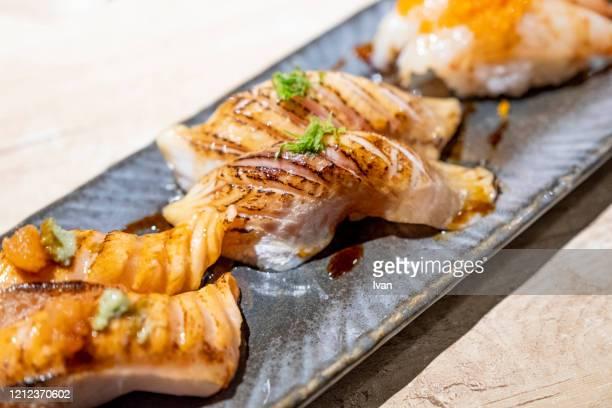 traditional japanese cuisine, set of salmon aburi sushi, sashimi, seafood - 天ぷら ストックフォトと画像