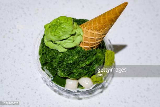 traditional japanese dessert, kakigori, shaved ice with matcha, green tea and cream - 冷凍食品 ストックフォトと画像