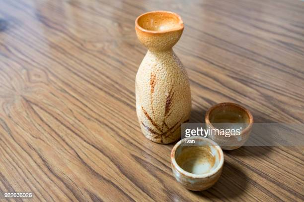 traditional japanese food, hot japanese rice wine (sake) - saki stock photos and pictures