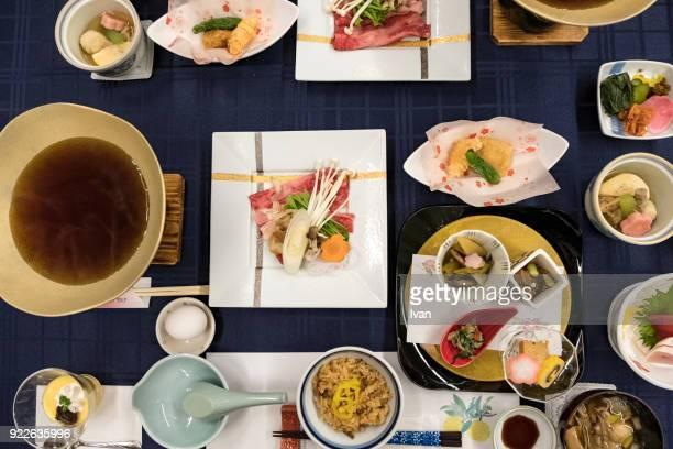 traditional japanese food, kaiseki cuisine with sukiyaki pot - washoku stock pictures, royalty-free photos & images