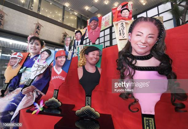 Traditional Japanese 'hagoita' battledores decorated with reliefs of newsmakers of the year 2018 are pictured in Tokyo on Dec 5 2018 Those featured...