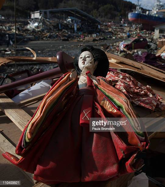 A traditional Japanese Hina Doll recovered from a destroyed home rests on top of debris on March 18 2011 in Kesennuma Miyagi Japan Thousands have...