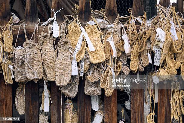 Traditional Japanese sandals made of straw hung as offerings at the Niomon Gate at Zenkoji Temple, Nagano, Japan.