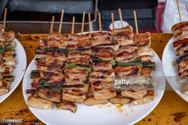 Traditional Japanese Street Food, grilled chicken, bird with roasted onion