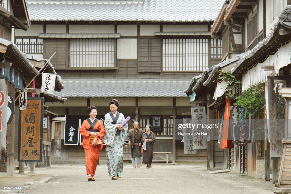 Traditional Japanese village, Edo period, habitants walking down the street : Stock Photo