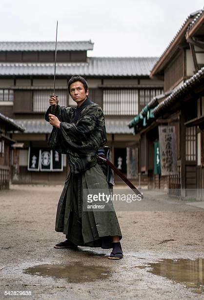 traditional japanese warrior - samurai stock pictures, royalty-free photos & images