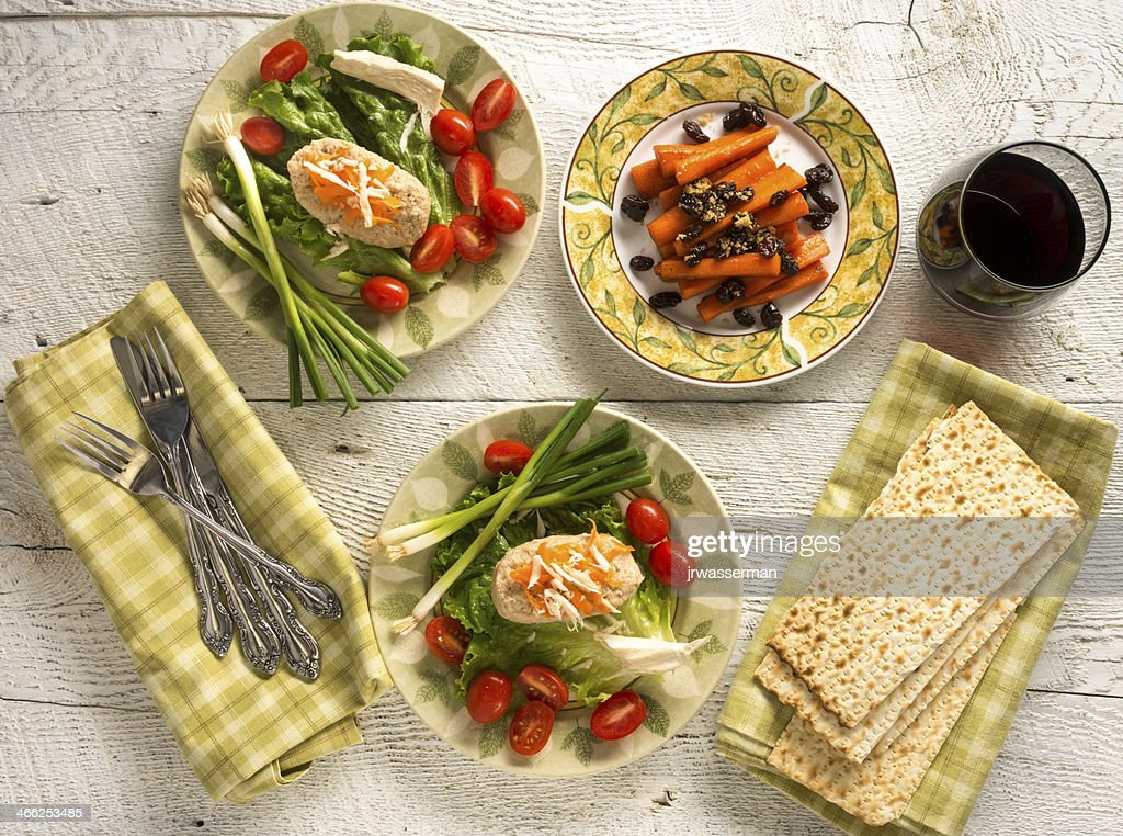 Traditional Jewish Passover dishes of Gefilte Fish and Tsimmes : Stock Photo