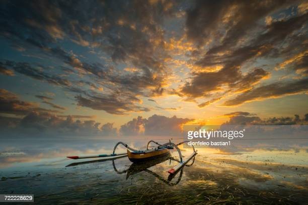 Traditional junk boat at sunset, Sanur Beach, Bali, Indonesia