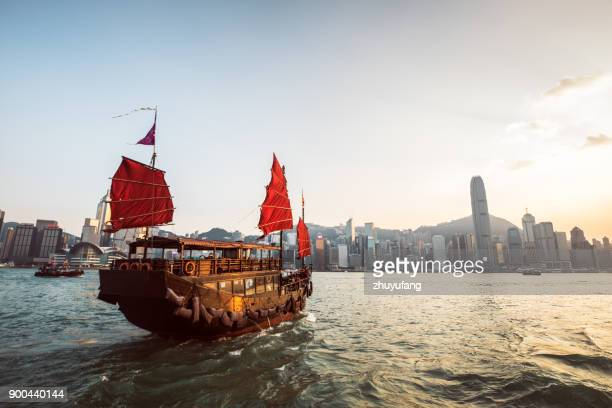 traditional junk boat at the victoria harbour - hong kong stock pictures, royalty-free photos & images