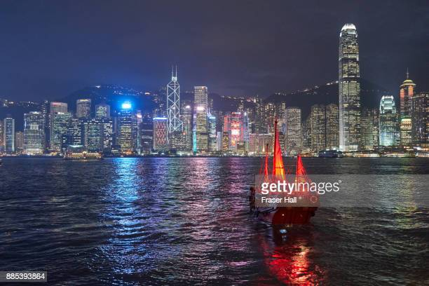 Traditional junk boat on Victoria Harbour at night, Hong Kong