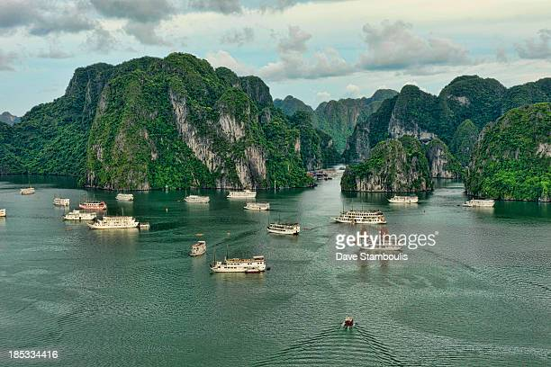 CONTENT] traditional junks sailing in Halong Bay Vietnam