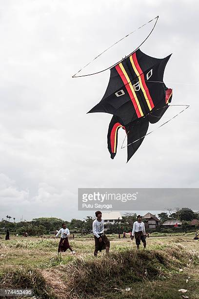 A traditional kite flies the during Bali Kite Festival on July 26 2013 in Denpasar Bali Indonesia The event is a seasonal religious festival which is...