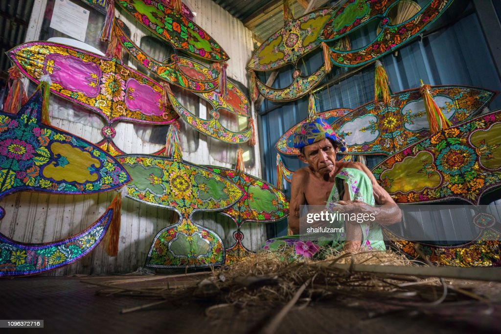 "Traditional kite maker or ""wau"" in Kelantan, Malaysia. : Stock Photo"