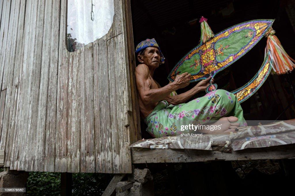 "Traditional kite maker or ""wau"" in Kelantan, Malaysia. : Stock Photo"