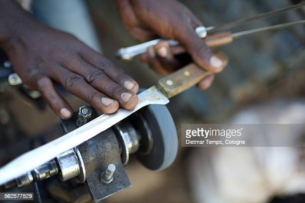 traditional knife sharpening, africa - dietmar temps stock photos and pictures
