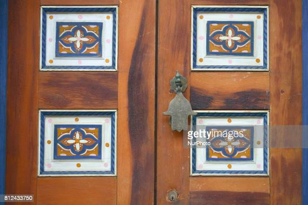 A traditional knocker and traditionally decorated door seen in Rabat's medina On Friday June 30 in Rabat Morocco